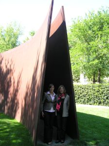 Carlita and Christine embraced by a Richard Serra